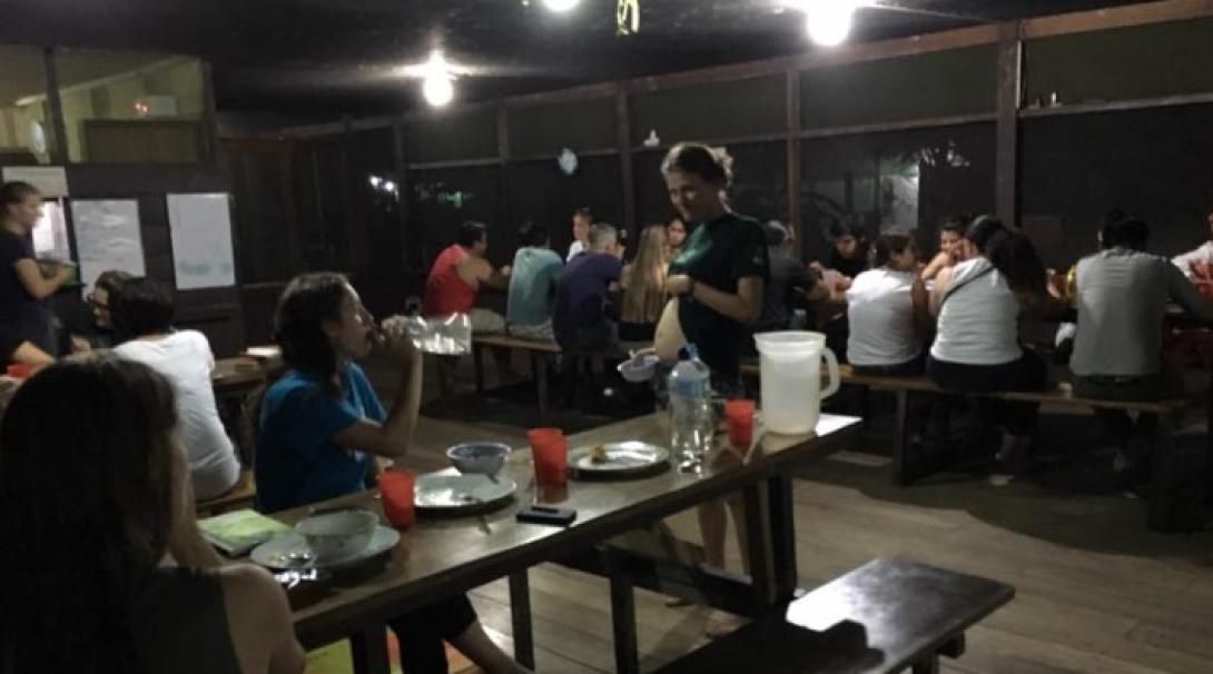 Volunteers eating in the dining room at Taricaya
